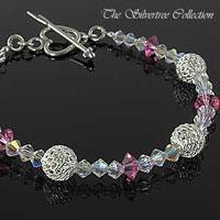 Armband med Swarovski kristaller & silver pärlor