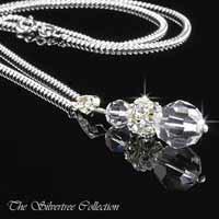 Hänge med kristaller och infattade kristaller i en silverkula