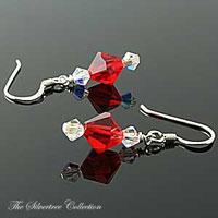 Örhängen med röda och klara kristaller