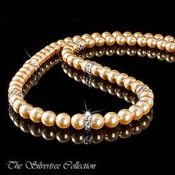 Pärlhalsband med guldfärgade pärlor
